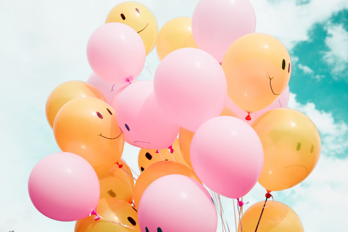 Bunch of balloons some smiling some frowning