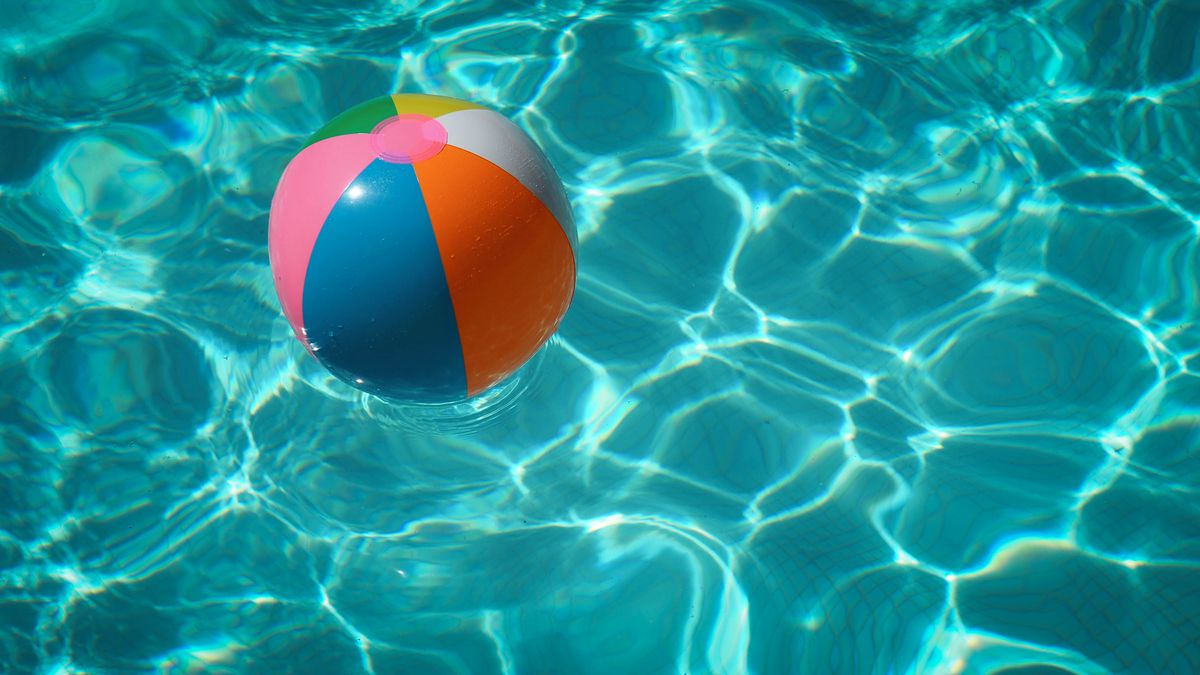 A beach ball floating in a clear swimming pool