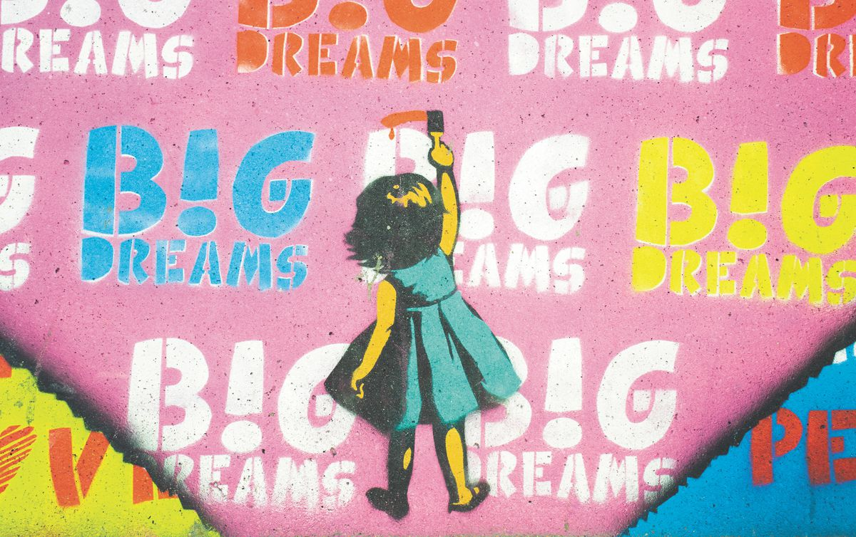 Pink graffiti with little girl painting big dreams